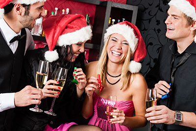 People drinking and laughing at a holiday party